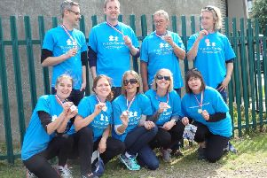 The Puzzle Centre abseiling team with their medals