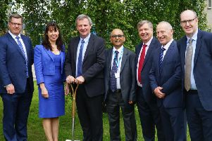 Cathal OHare, Project Director OHMG; Roisin Coulter, Director of Planning, Performance & Informatics, South Eastern HSC Trust; Richard Pengelly, Permanent Secretary, Dept of Health; Deep Sagar, Chairman, South Eastern HSC Trust; Eamon OHare, OHMG Director; Martin Lennon, OHMG Managing Director and Neil Guckian, Interim Chief Executive, South Eastern HSC Trust.