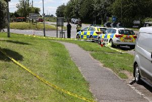 Police in Little Harrowden after the incident on June 21