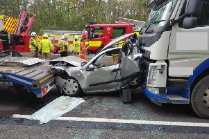 The car was crushed between two lorries on the M1 near Northampton. Photo: Northamptonshire Police