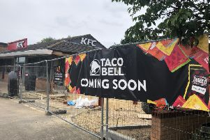 'Coming soon' signs have now gone up on the fencing surrounding the new Taco Bell.