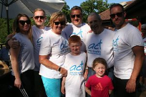 The Brazier family and friends pictured at Leighton Buzzard Golf Club after completing their 68-mile charity walk
