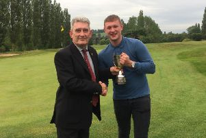 Rugby Golf Club Captain, Camillus McCarron presents Captain's Day winner Aidan March with the trophy
