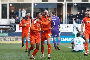 James Justin celebrates scoring for the Hatters