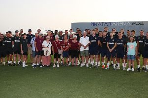 The Cobblers supporters and players get together for a team group