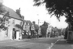 Looking south through Purbrook village with the Leopard pub on the right. Picture: Barry Cox postcard collection