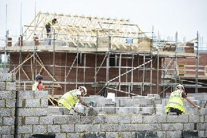 File photo of builders on a building site. Picture: Ben Birchall/PA Wire