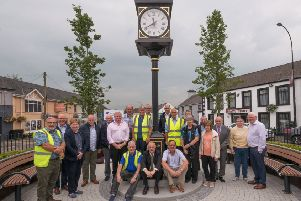Representatives from Mid and East Antrim Borough Council, Ahoghill Traders' Association and volunteers and the new clock in Ahoghill.'The traditional chimes of Big Ben will now ring through Ahoghill following the installation of a new village clock. The �90,000 project, which included the new clock and enhancements to the Diamond area, are part of the village renewal scheme. Standing at four metres tall the four sided pillar clock takes pride of place in the heart of the village. Mounted on a steel column and sitting on a granite raised plinth it is a real focal point for visitors and locals.