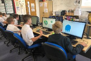 Caroline Chisholm School students busy working on the Internet of Things project. Photo: Kay Sawbridge