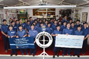Northampton Sea Cadets members are given a cheque for 1,000 from Dee Smith from David Wilson Homes South Midlands