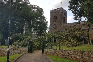 An enormous tree branch narrowly missed crashing in St Andrews Church in Great Billing.