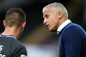 Keith Curle has a word with Billy Waters. Picture: Pete Norton