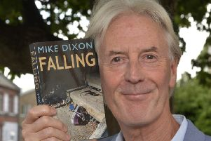 """Mike Dixon with his new book """"Falling"""" (Photo by Jon Rigby) SUS-190808-111339008"""