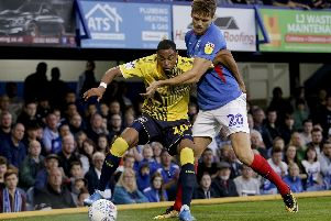 Sean Raggett, pictured challenging Coventry's Wesley Jobello, endured a difficult full debut for Pompey. Picture Robin Jones