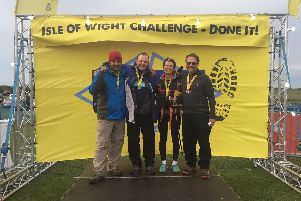 Adrian Faure, Alistair Gibson. Louise Carver and Jeremy Grant after completing their walk around the Isle of Wight - next stop the Sahara Desert to raise more funds for the Rosemary Foundation