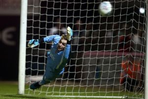 Out of reach: Andrew Fisher can't quite get to a penalty. Picture: Pete Norton