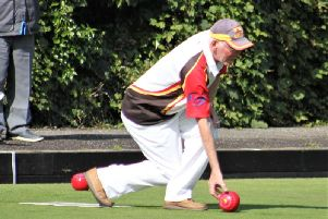 Sam McCombes delivering his bowl against Sydenham