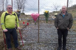 Marian'younger brothers Gerard and Fergal laying flowers and lighting candles at the area where Marian was killed.