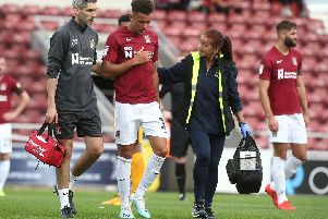 Shaun McWilliams leaves the field with chest problems. Picture: Pete Norton