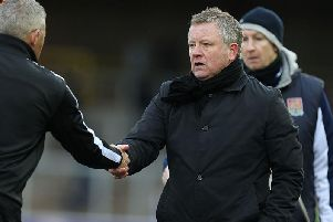 Then-Carlisle manager Keith Curle shakes hands with Chris Wilder after Cobblers' victory at Brunton Park in 2016.