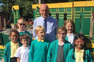 Head teacher, Howard Payne, with pupils, from left, Ariane Kamakoue, Liam Goble, Mickey Stanley, Max Butcher, Delia Dumitru, Maisie Clarke and Chanulya De Silva.