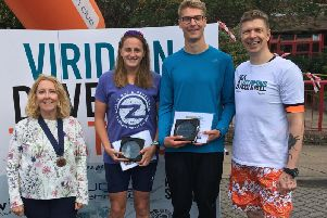 Viridian Daventry Triathlon 2019 overall individual winners - (from left)Daventry Town Deputy Mayor Cllr Lynne Taylor, Sophie Kirk, Jack Bond and Tom Welch, Marketing Manager Viridian Nutrition.