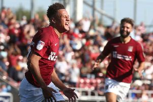 An ecstatic Shaun McWilliams sets off to celebrate his first Cobblers goal. Picture: Pete Norton