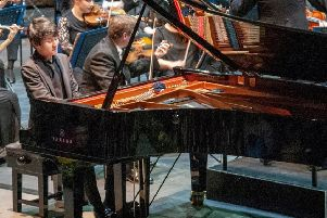 Fumiya Koido playing with the Royal Philharmonic Orchestra at the Hastings International Piano Concerto Competition