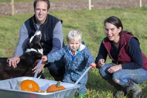 Farmer Tom Harris and his wife Lucy pictured with their son, George. Credit: Kirsty Edmonds.