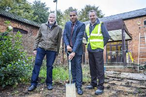 Chair of Rectory Farm Residents' Association Toby Birch, borough councillor for Rectory Farm James Hill and construction director for Goodfellow Stuart Johnson on site at the community centre.