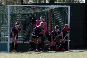 Portsmouth women about to defend a penalty corner against Trojans