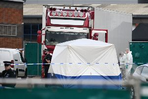 THURROCK, ENGLAND - OCTOBER 23: Police and forensic officers investigate the site where 39 bodies were discovered in the back of a lorry on October 23, 2019 in Thurrock, England. The lorry was discovered early Wednesday morning in Waterglade Industrial Park on Eastern Avenue in the town of Grays. Authorities said they believed the lorry originated in Bulgaria and entered the country at Holyhead on October 19. The suspected driver was arrested in connection with the investigation. (Photo by Leon Neal/Getty Images)
