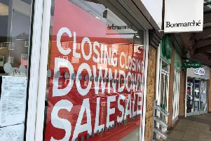 'Closing down sale' signs in the window of Bonmarche in Bowen Square, Daventry