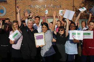Staff at Ashurst Mews Care Home in Moulton celebrate the 'outstanding' rating from the CQC