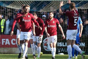 Vadaine Oliver takes the plaudits after scoring his first goal for the Cobblers, heading home Nicky Adams' cross 25 minutes into Sunday's tie. Pictures: Pete Norton