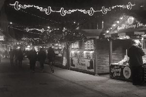 There's no better spot for a Christmas photo than under the market's fairy lights. Picture: Portsmouth Christmas Market