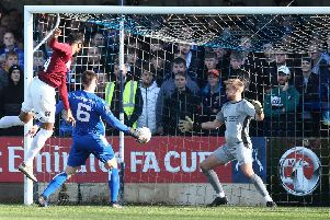 Vadaine Oliver rose high to head home Nicky Adams' cross and score his first goal for the Cobblers on Sunday. Picture: Pete Norton