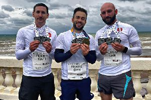 Matt Roberts (left), Dan Foreman (centre) and Sam Harman celebrate their sucess after completing the Poppy 100k run. Picture courtesy of Dan Foreman