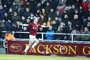Scott Wharton wheels away in delight after scoring his fourth goal in three games. Picture: Pete Norton