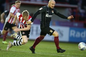 Alan McCormack holds off his man during Saturday's game at Exeter. Picture: Pete Norton