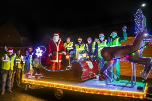 Santa pictured in Roade last night with his helpers. Pictures by Kirsty Edmonds.