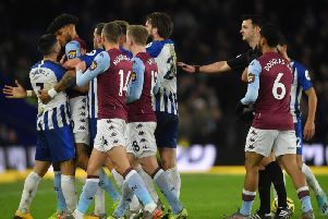 Neal Maupay squares up to 6ft 5in defender Tyrone Mings during the 1-1 draw with Aston Villa at the Amex Stadium