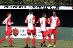 Remy Brittain takes the congratulations after he scored the first of his two goals in Whitworth's 2-1 victory over Harborough Town. Pictures by Alison Bagley