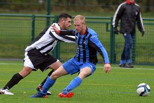 Action from Moulton's 6-0 victory over Corby Peagsus in the Premier Division. Picture by Dave Ikin