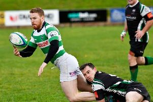 City of Derry's Simon Logue hauls down Omagh winger Neil Brown. DER4518-104KM