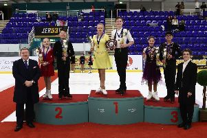 Corbys Stanley Evans and his ice dance partner Olivia Jenkinson stand on the top podium after their success in Sheffield
