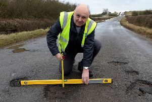 Mr Pothole, Mark Morrell, with potholes between Greatworth and Halse. NNL-180503-160309009