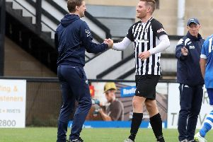 It was a good day for manager Steve Kinniburgh and striker Elliot Sandy, who hit a hat-trick in Corby Town's 4-1 success at Aylesbury