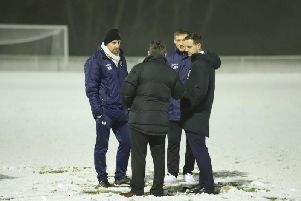 Steve Kinniburgh and assistant-manager Ashley Robinson talk things over with the match referee before Corby Town's midweek clash at Welwyn Garden City was postponed due to snow. Picture by Peter Short