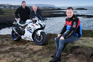 Richard Cooper with North West 200 Clerk of the Course Stanleigh Murrray and Event Director Mervyn Whyte on the North Coast last week.